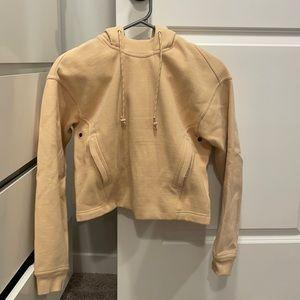 Lululemon hoodie. Size 2. NWOT. Peach color.